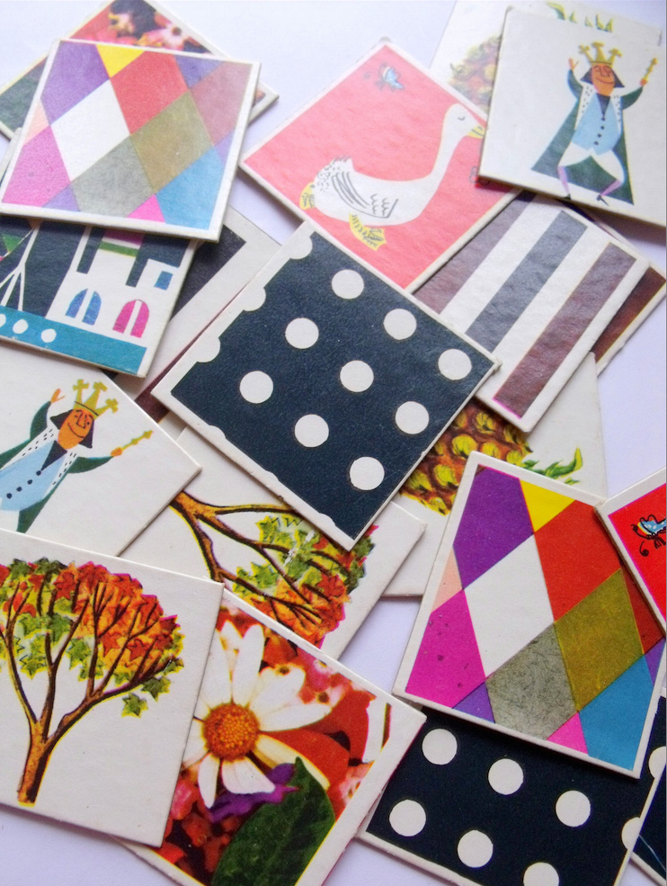 Get some old cards and lay them out. Then cover them with pretty paper