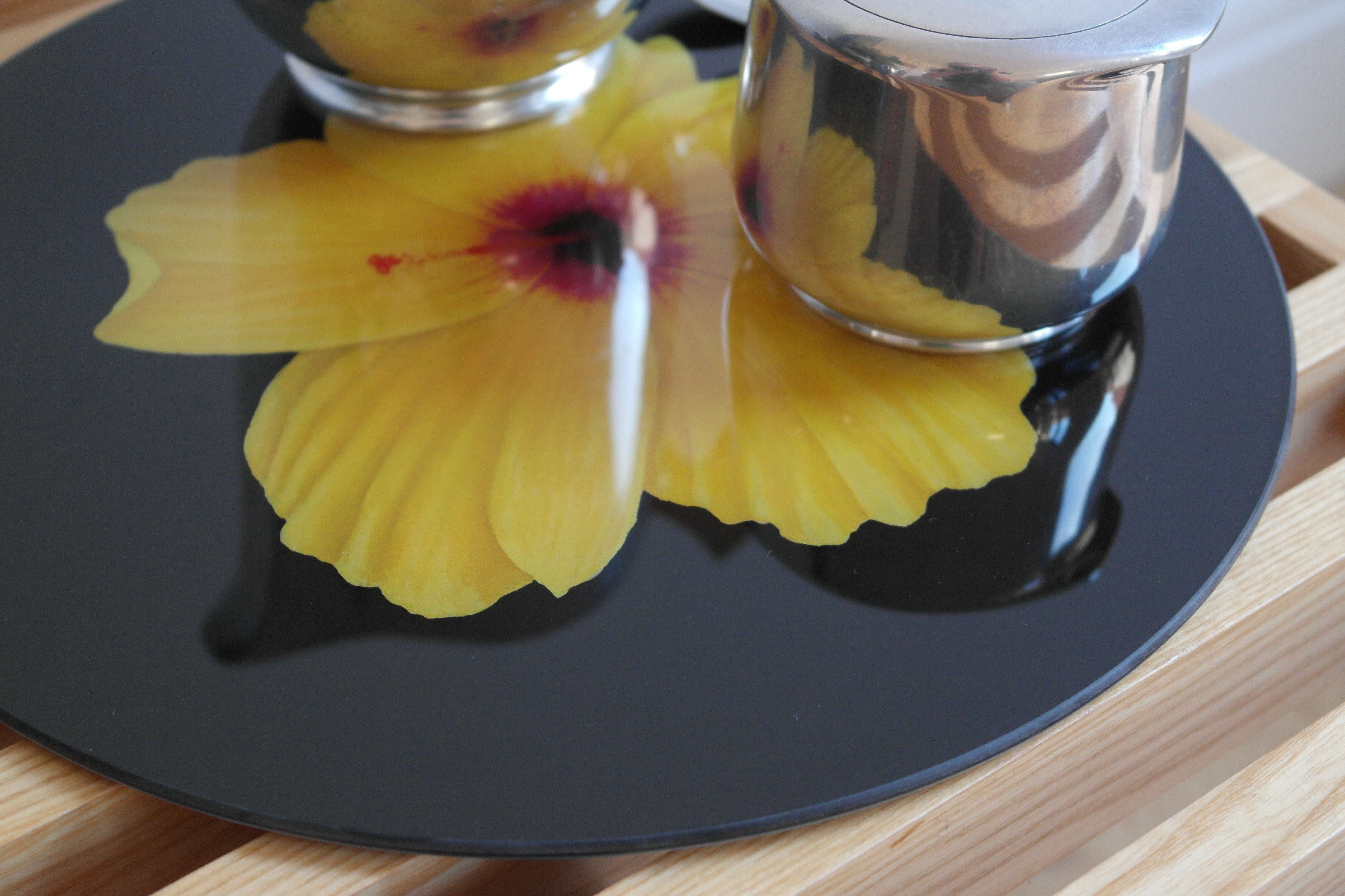 A stunner of a glass trivet - Hibiscus on black by Andrew Flint Design, £40
