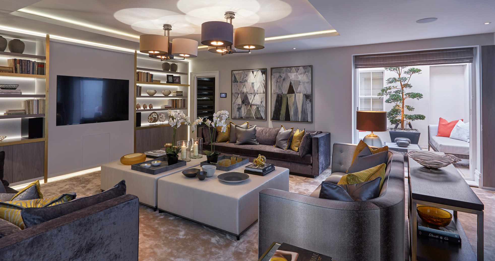 The family room at Wilton Street. Layer your lighting and invest in some paintings if you can