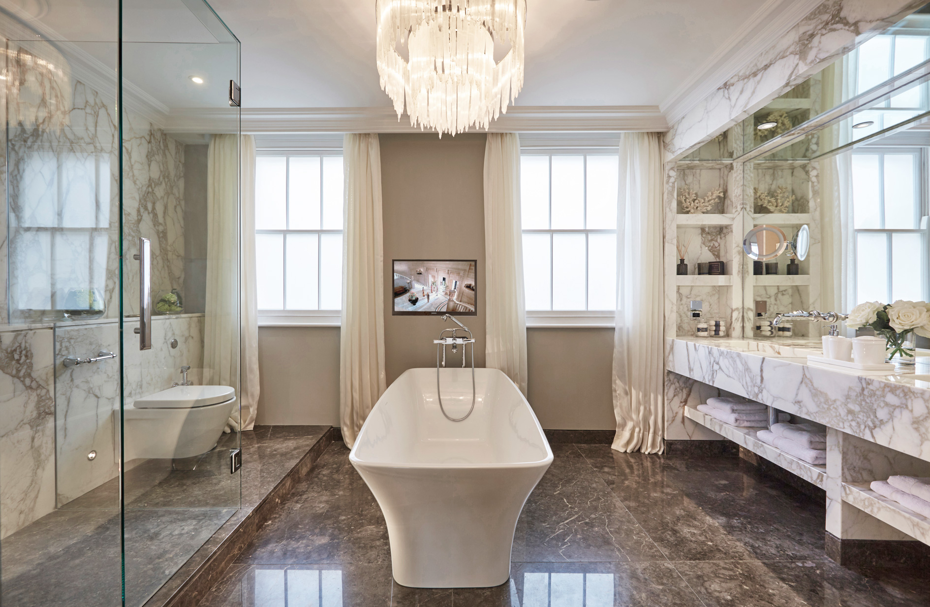 Master bathroom with bespoke chandelier and acres of carrara marble. A more eco alternative is to us