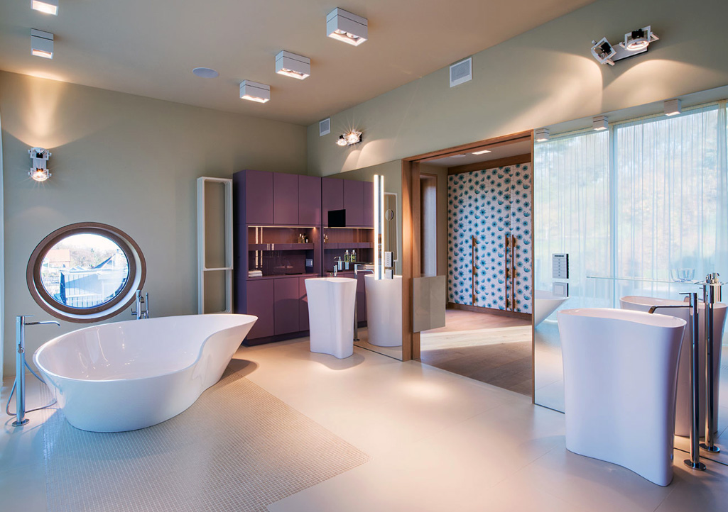The master bathroom has porcelain tiles and sanitary ware by Italian brand Falper