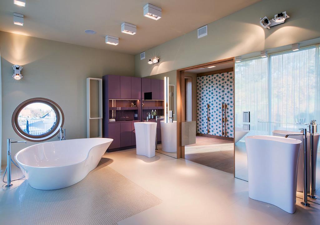 The master bathroom has porcelain tiles and sanitary ware by Italian brand Falper