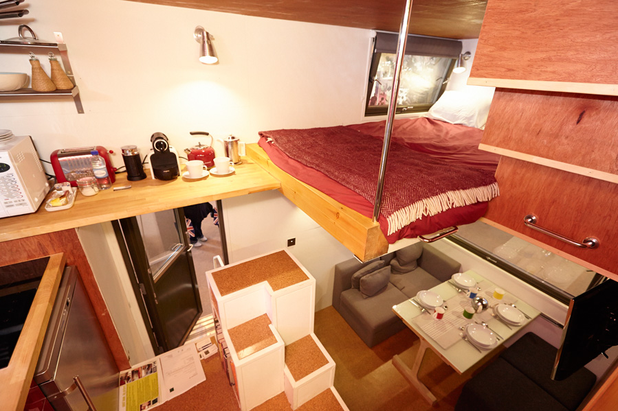 Interior of Dr Mike Page's Cube Project. Find everything two people need in a tiny space inc