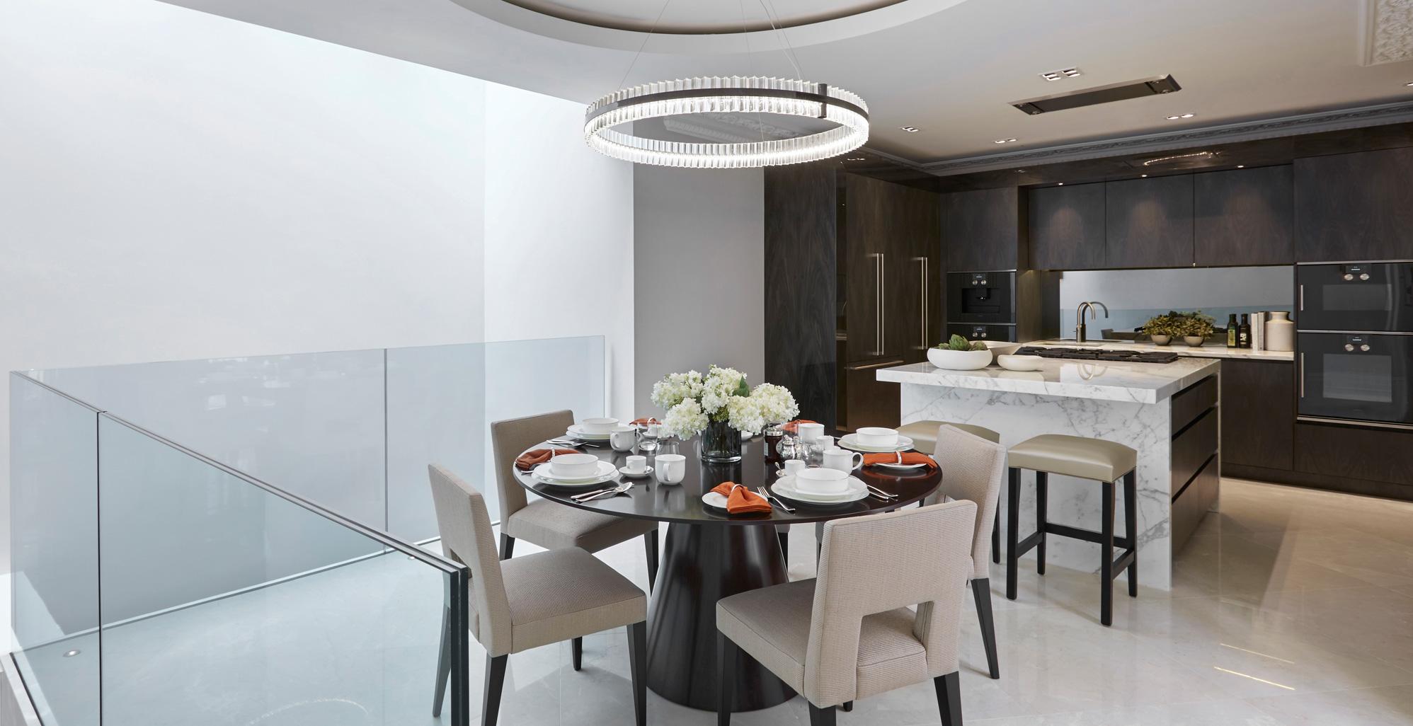 Kitchen at Wilton Street combines dark wood veneer and a marble island