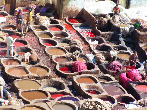 In Morocco tourists watch workers tread hides in vats of noxious dyes. The colours are pretty but wo