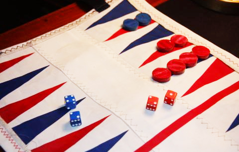 Perfect for evening games on deck...sailcloth backgammon set from Oarsum scrolls up when not in use.