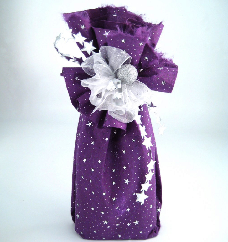 Thin sheets of felt wool can be used for gift wrapping..make it festive with some eco glitter