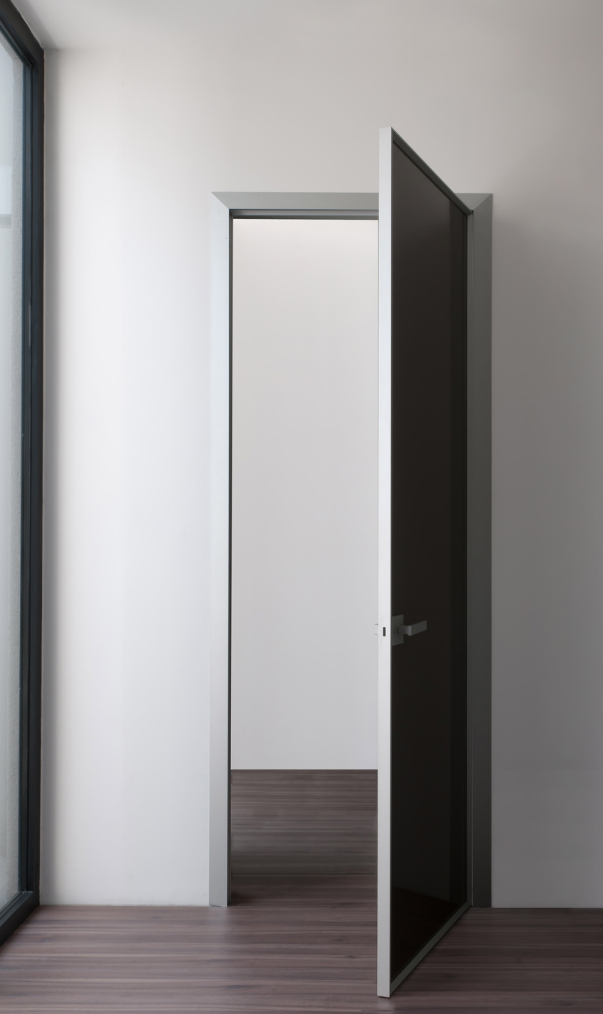 Albed's Filum door comprises glass in an aluminium frame. Fully recyclable.