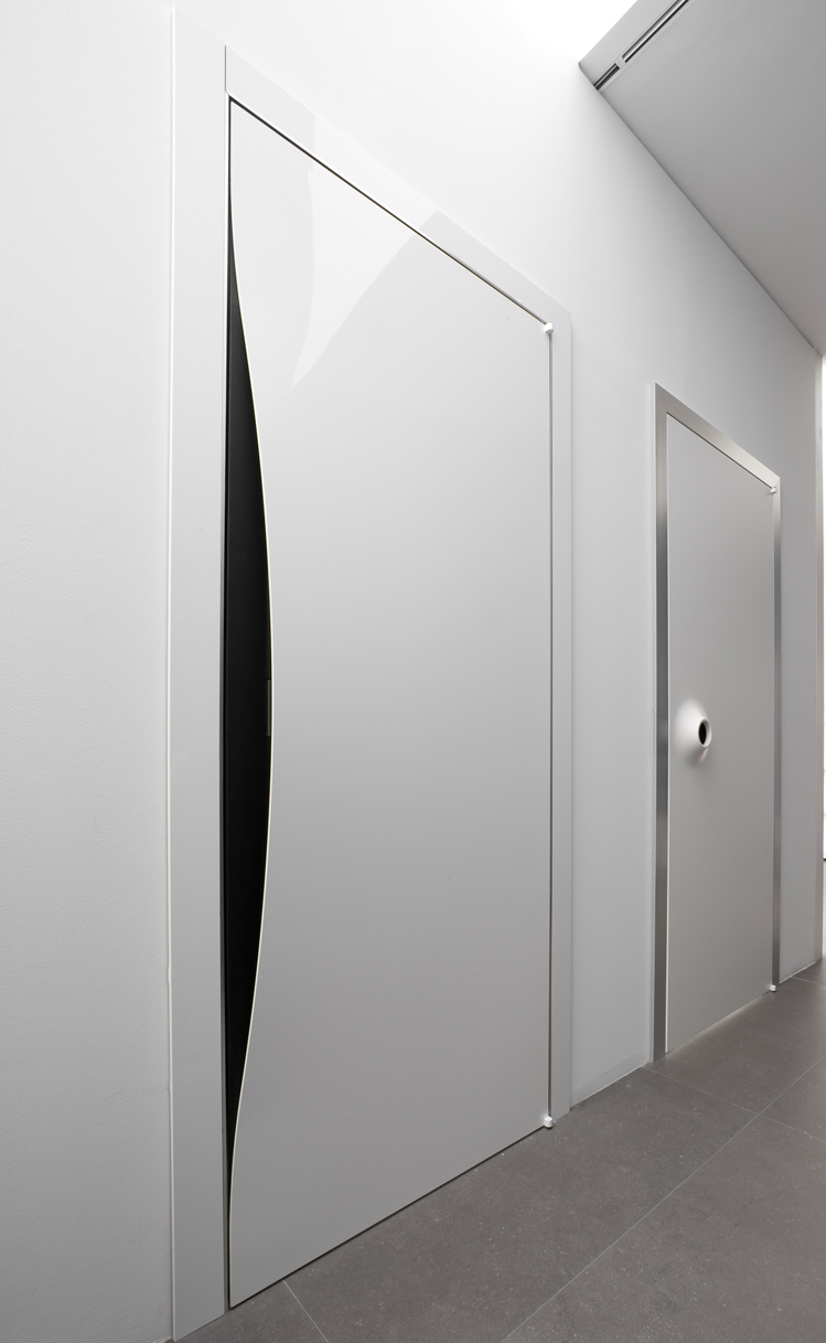 Albed's Blow aluminium framed door with an MDF centre. www.albed.it