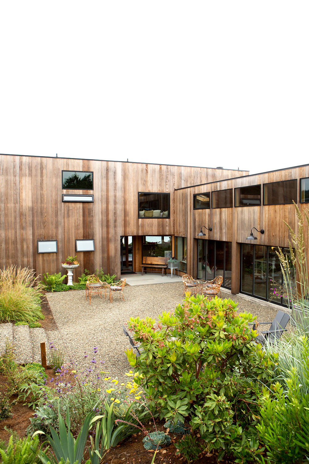 The outside plantings are designed to blend in with the natural environment