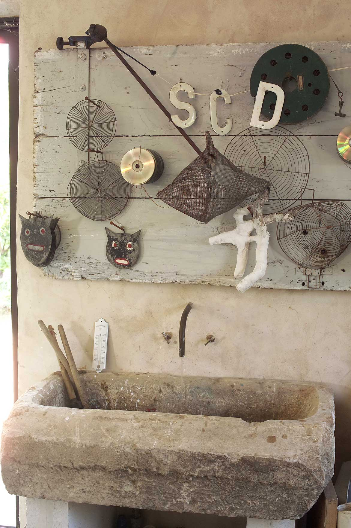 The owners visited salvage yards for characterful pieces such as this stone basin