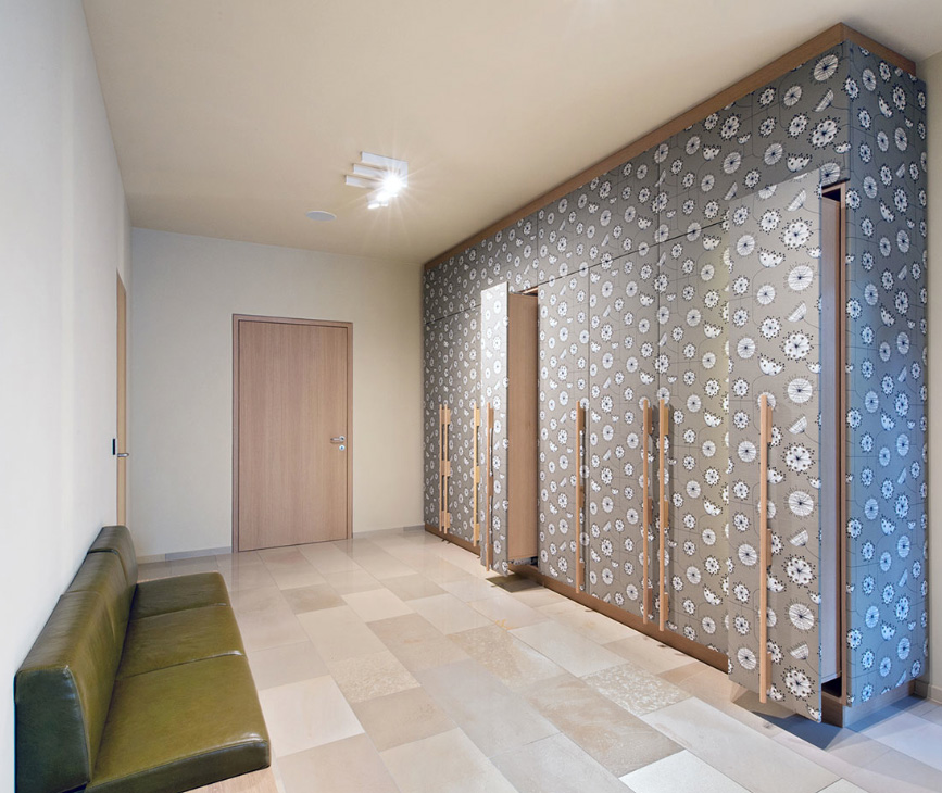 Pull-out wardrobes have been covered with Dandelion cotton/linen fabric by Essex-based Miss Print