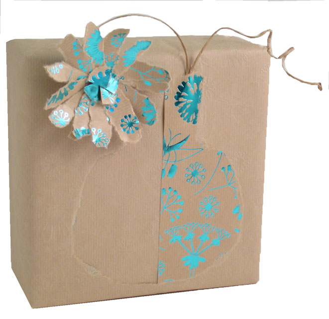 Brown paper packages tied up with string and decorated with stencil motifs