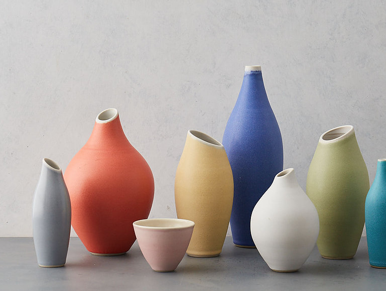 Sue Ure wheel-thrown vases come in lovely pastel shades. Yellow Alto vase (fourth from left) £36.75