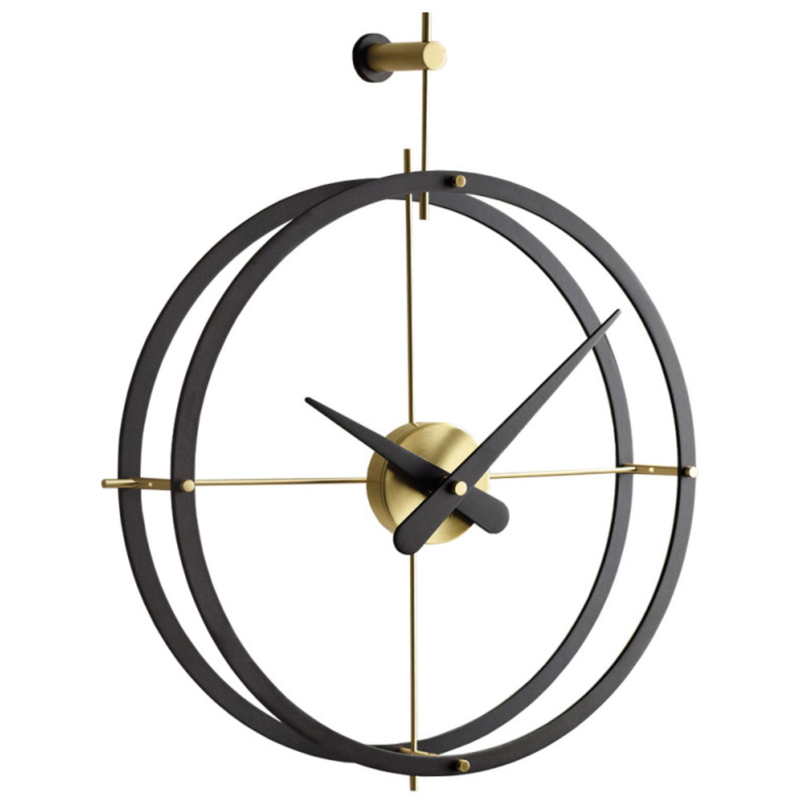 Spanish brand Nomon makes very elegant modern clocks, including this  2Puntos, wood and metal