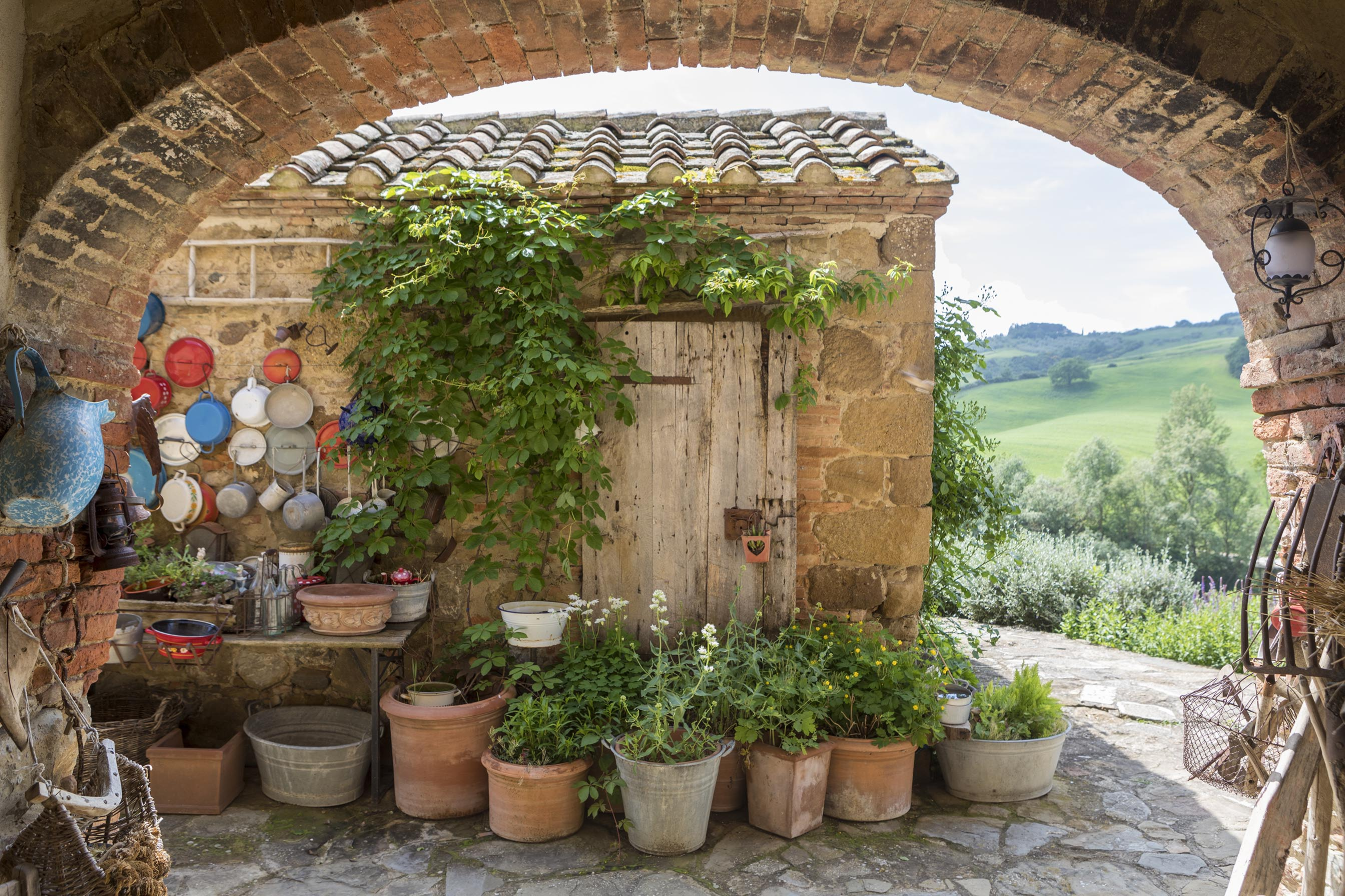 lots of plant filled terracotta pots and keep your pans up on the barn wall!