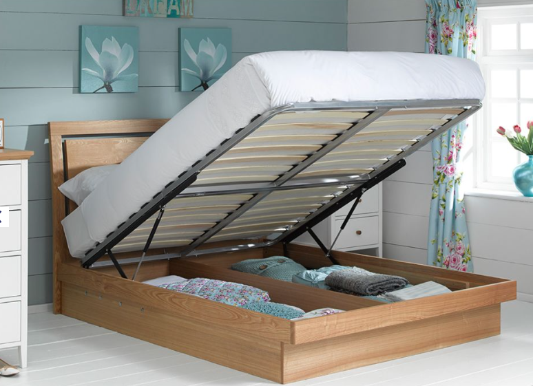 A bed with storage is essential in a small room. Isabella oak framed bed with oak veered panels, £59