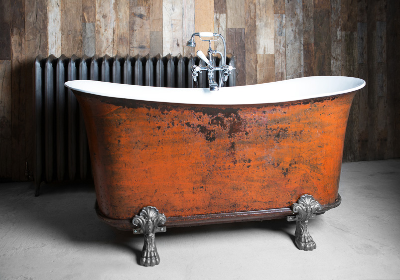A reclaimed claw foot bath at Masco's restored with a distressed finish requested by the client