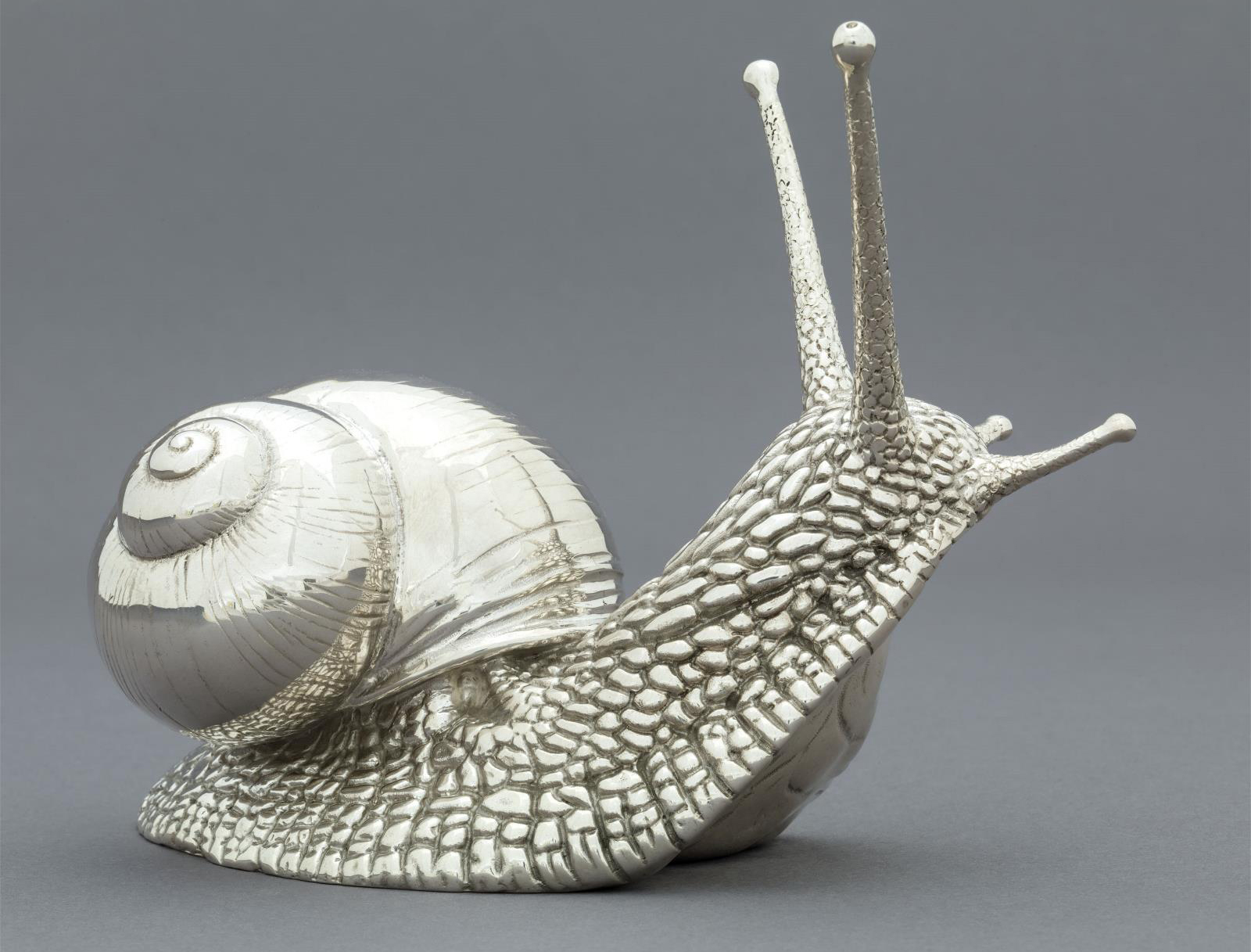 Garden Snail in silver, by sculptor Nick Bibby. It won't be munching your hostas