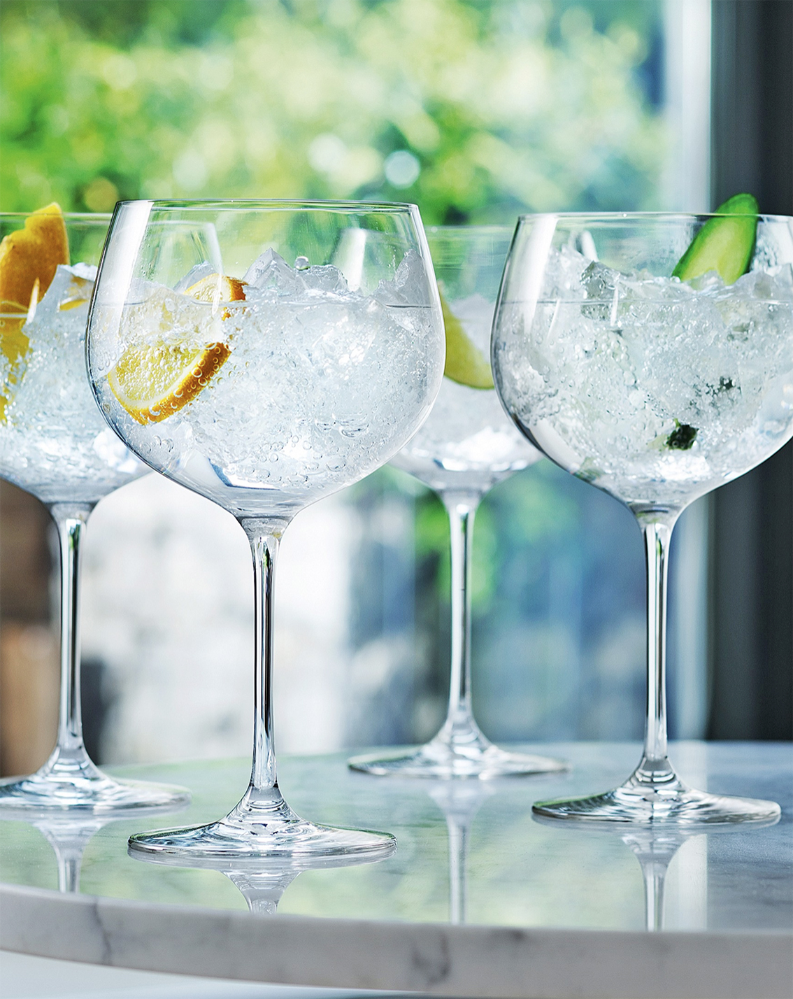 Celebrate with gin in a glass meant for gin & tonic..gin balloon glasses, £30 for 4, LSA