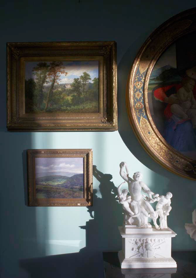 A vignette of paintings and objets