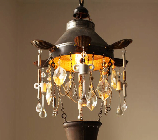 At first glance you may not notice the upcycled materials in the chandeliers