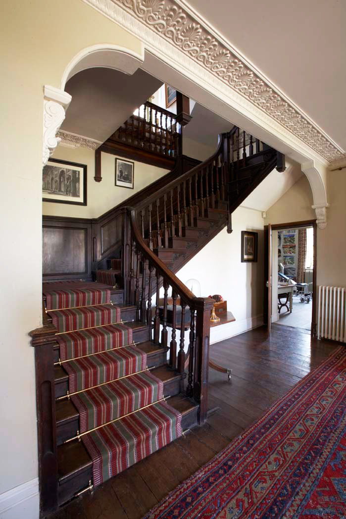 The staircase has a flatweave runner