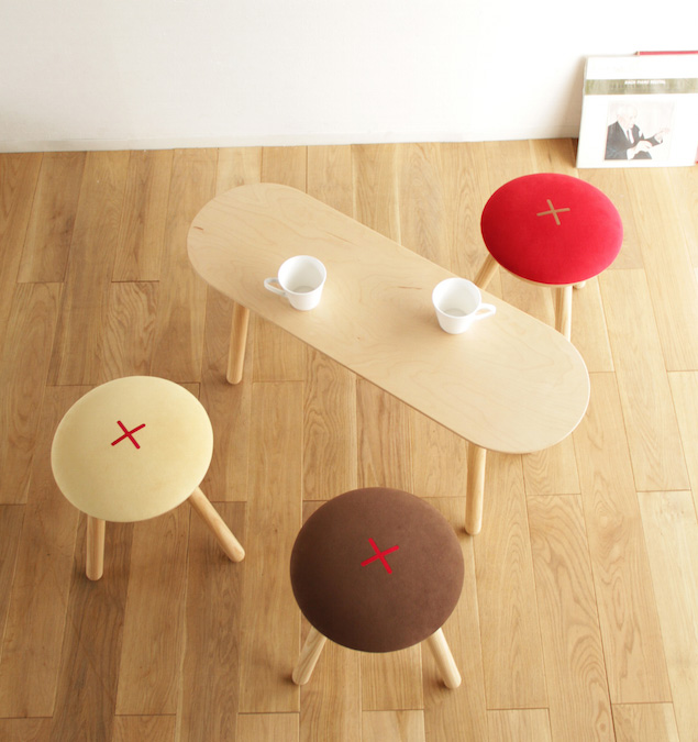 Muffin small oak table and felt-covered stools from Stone Designs of Madrid.