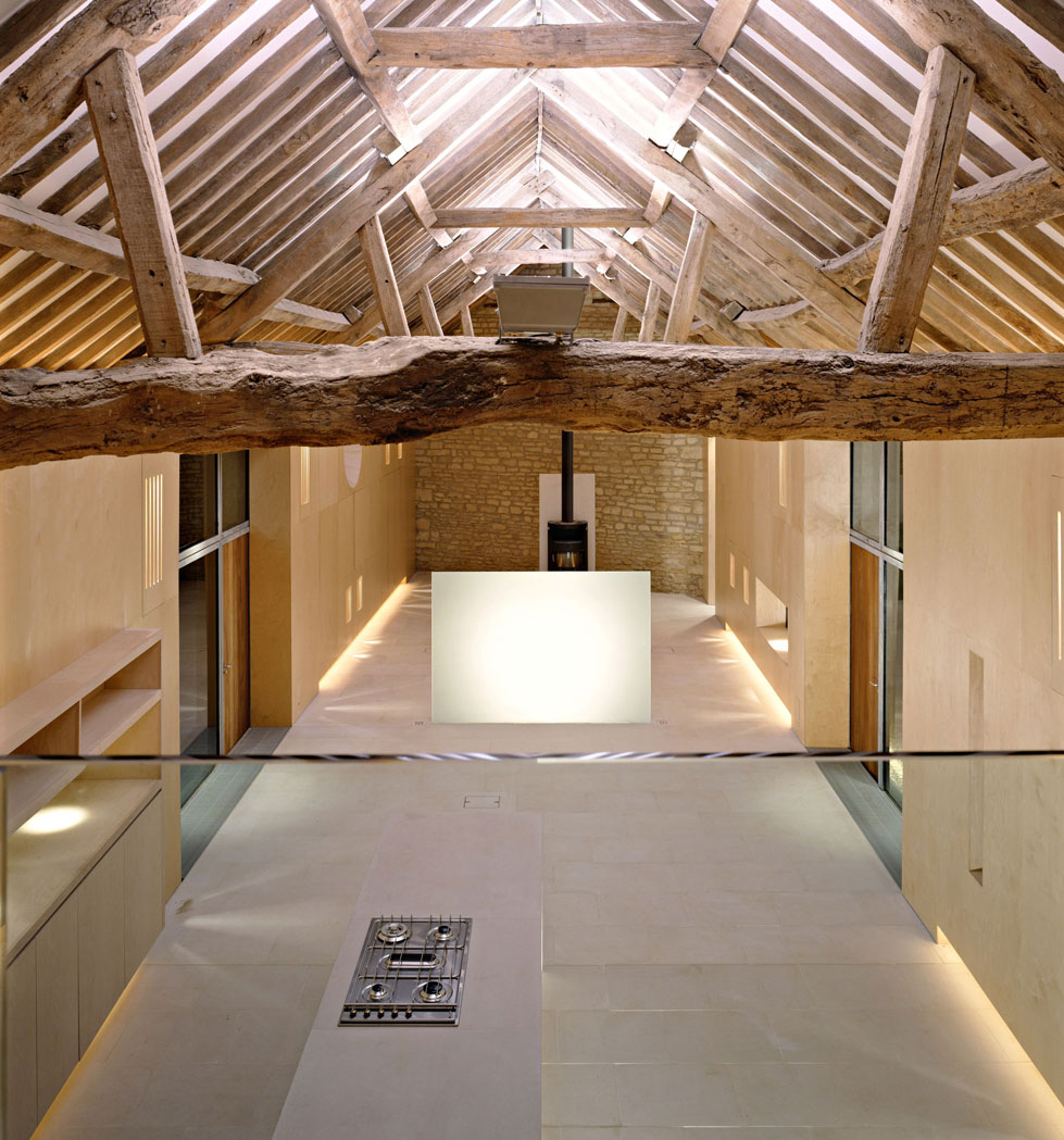 This barn has been given a minimalist interior, with American white oak kitchen units.