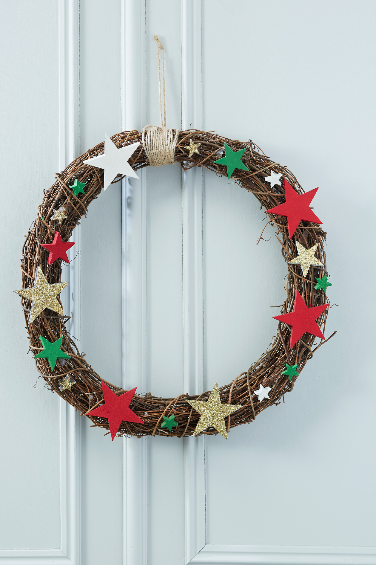Make your own decorations..start with a plain natural rattan wreath from Hobby Craft, £3