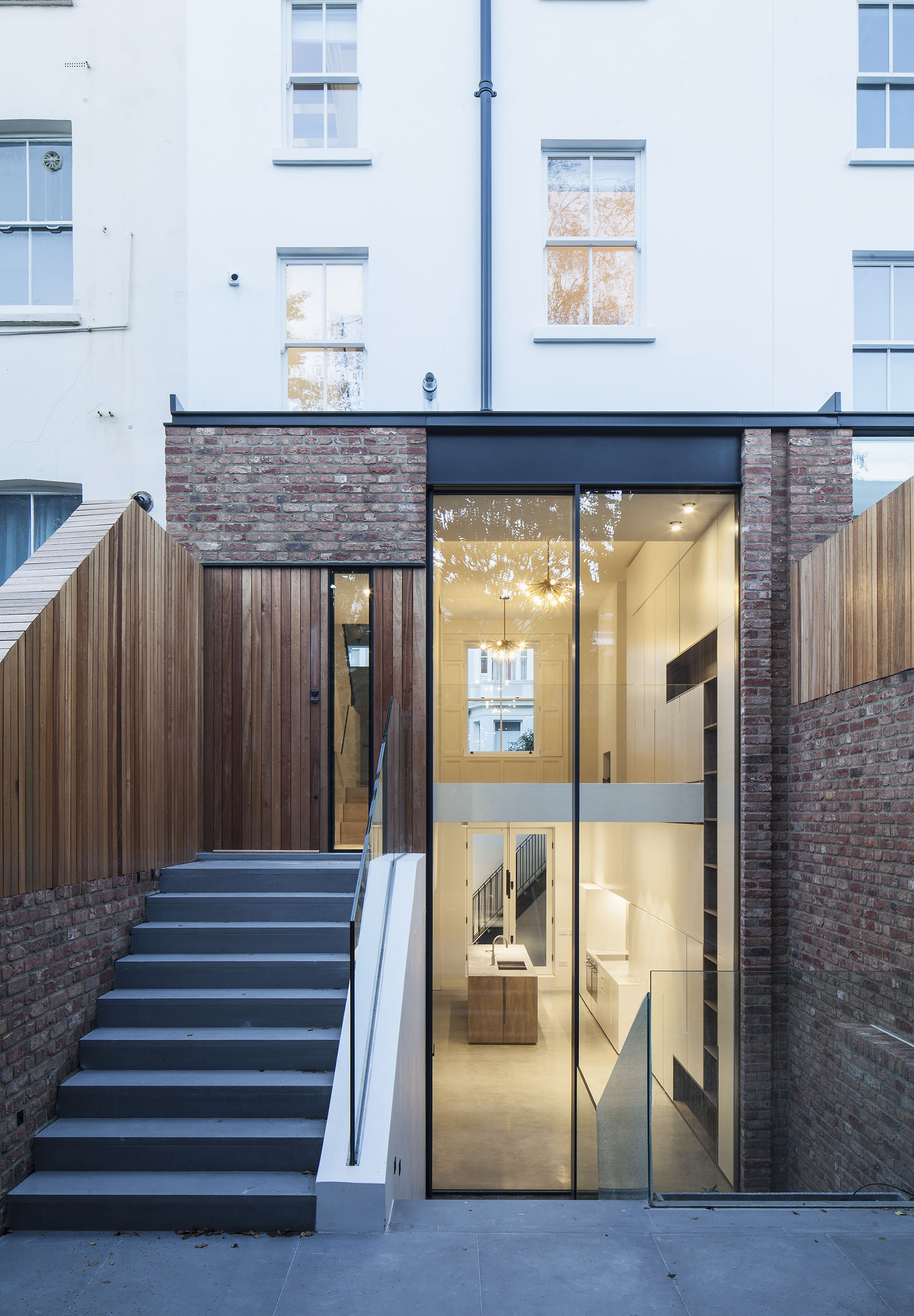 This glass extension uses clear glass interior doors