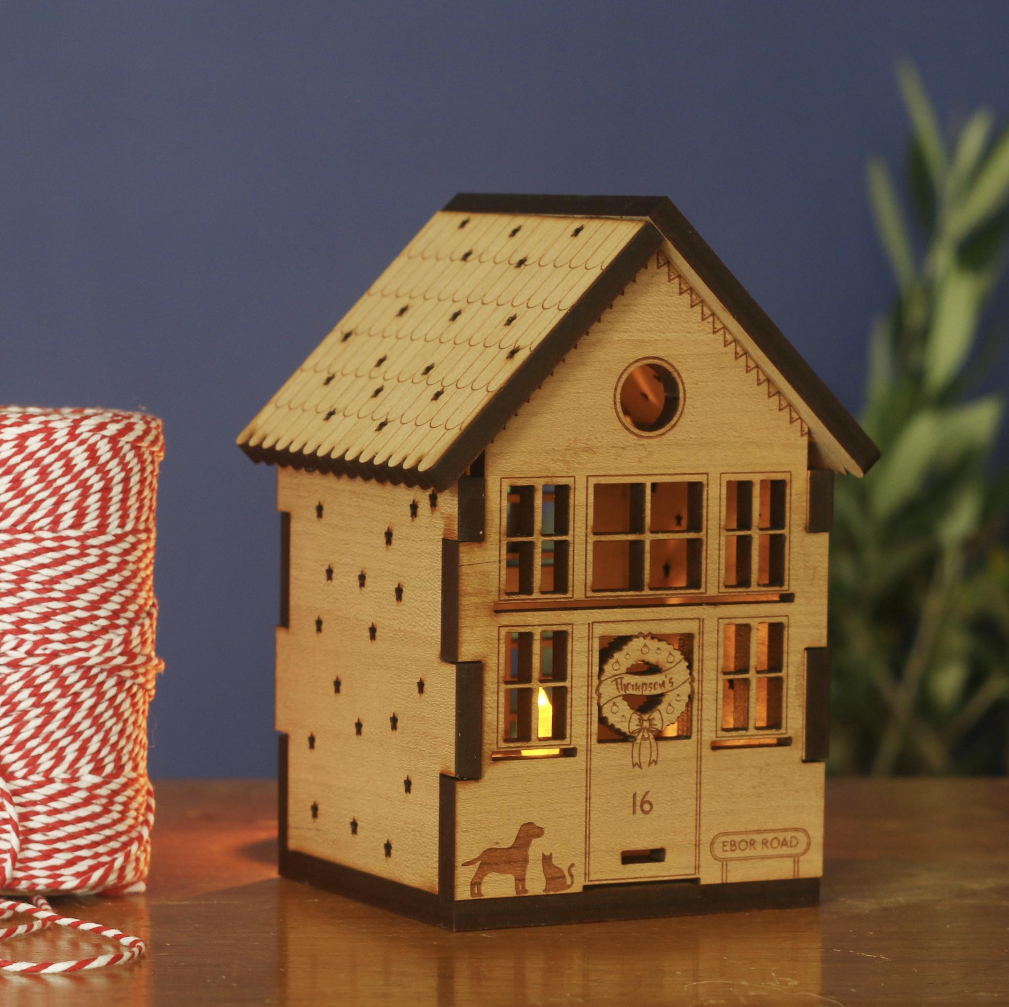 Wooden miniature house for tea lights, made in Cheltenham, www.betsybenn.co.uk