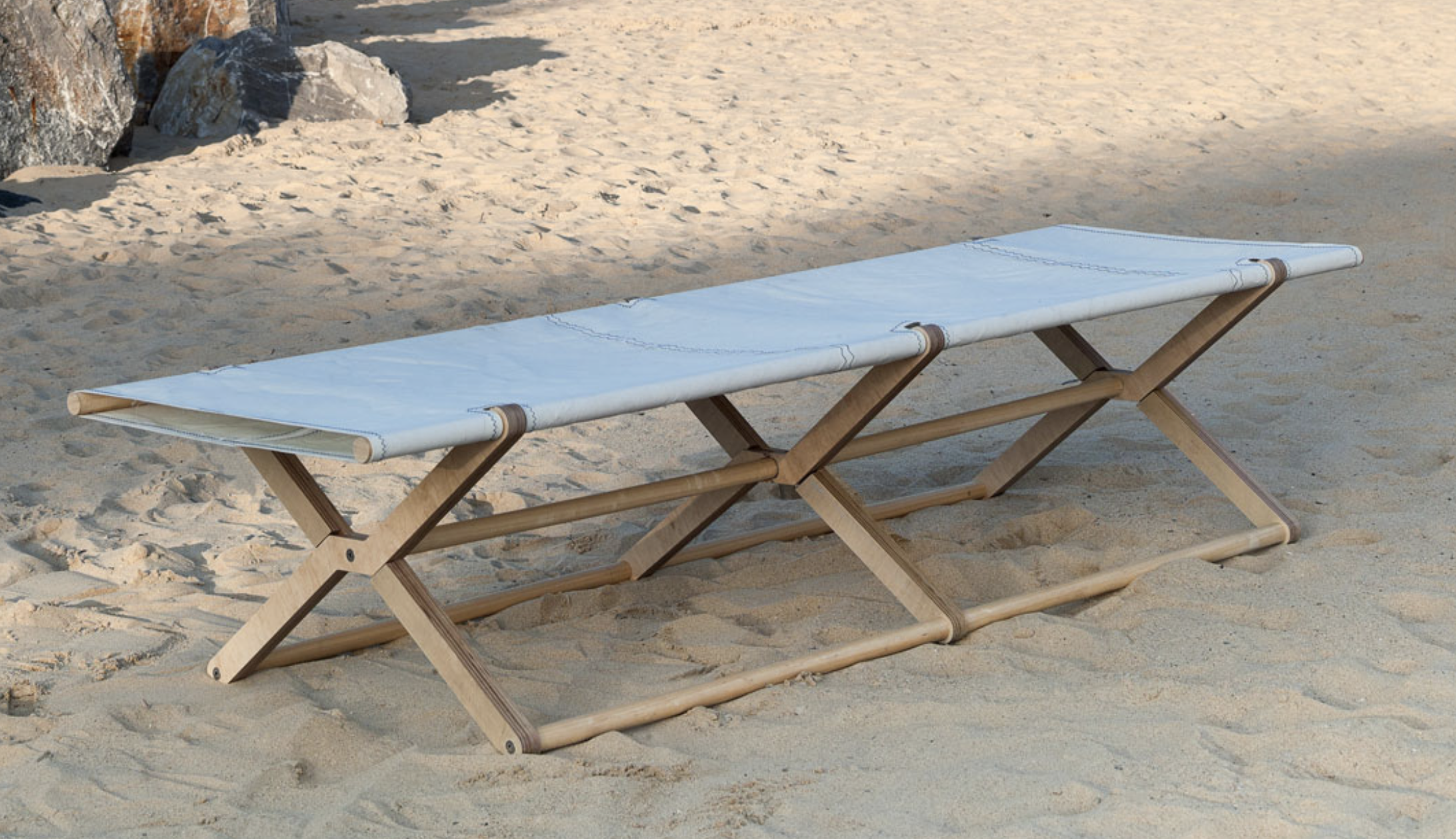 Coy foldable daybed from Dvelas, made from recycled sails and plywood