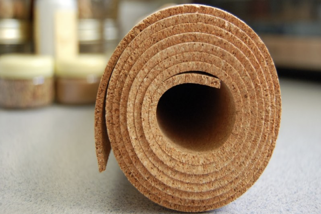 Buy a roll of cork for noticeboards, or cover your wall with it and paint it...£41.88 2m roll