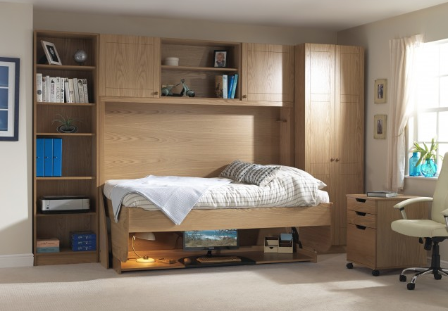 The Study Bed converts from a desk to a bed in three seconds. Wood veneer on MDF frame. From £1,680.