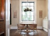 Table and chairs by Gareth Neal, engraved stone wall panels by Gary Breeze and metal pendant light by Junko Mori