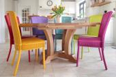 Stamford dining chairs in various bright colours by Lloyd Loom of Spalding.