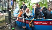 Marius Smit of Plastic Whale stands at the back of the boat