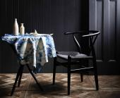 Shibori leather tablecloth by Pepa Martin and Karen Davis
