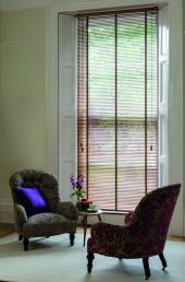 Timberlux blinds in light oak are refined and have a delicate look