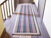 Anta eco friendly Uist wool runner on a wooden floor