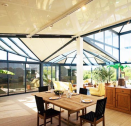 Conservatory using special recycled aluminium roof panels by France's AV Composites