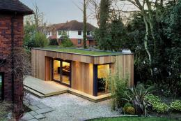Westbury Garden Rooms made this space in sustainable red cedar with a natural grass roof. www/estburygardenrooms.com