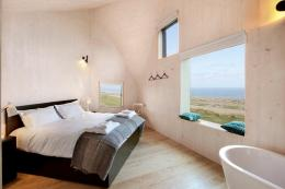 Bedroom in The Dune House by Mole Architects