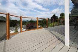 Trex Contour boards have a 25-year fade and stain warranty. A soap and water wash once or twice a year will keep the deck looking as new, says the company