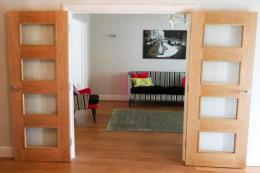 You might choose to widen a doorway to allow for double doors. Bespoke oak veneer and glass modern doors from www.modern-doors.co.uk