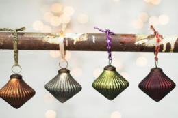 Recycled glass baubles by fair trade Devon-based retailer Nkuku, £14.95 for set of 4