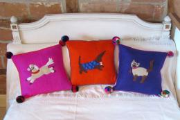 Sew Heart Felt's hande-made Pet Collection cushions for children, made from merino wool with felted detail and wool pompoms, £34.95 each. www.sewheartfelt.co.uk