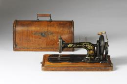 Singer sewing machine with plywood box, 1888. V&A image