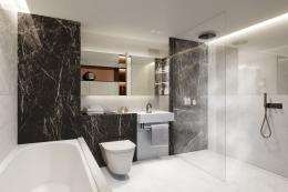 A four-piece bathroom. Naylor specifies small amounts of EU sourced marble to be combined with porcelain tiles